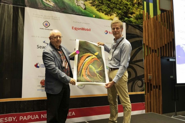 Convenor. Mick McWalter presenting local painting as gift to Keynote Speaker Jeroen Kenter, Total SA