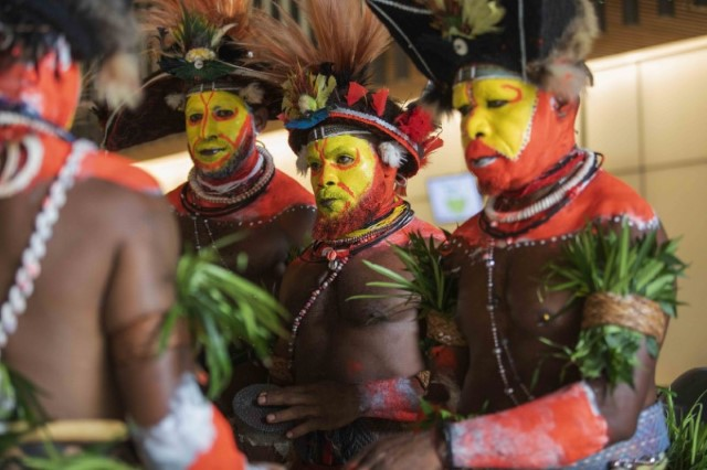 Hela Dancers line up to welcome delegates